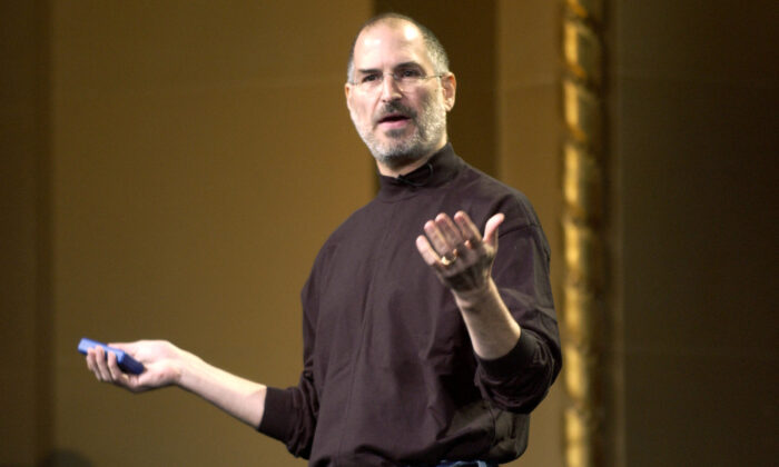 Steve Jobs of Apple Computer celebrates the release of a new Apple iPod family of products at the California Theatre in San Jose Calif., on Oct. 26, 2004. (Tim Mosenfelder/Getty Images)