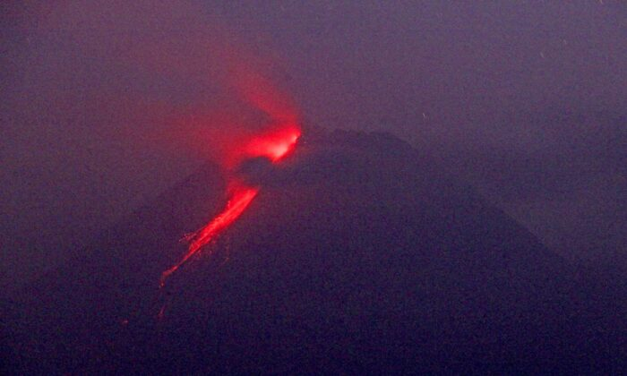In this photo taken using slow camera shutter speed, hot lava runs down from the crater of Mount Merapi, in Sleman, Yogyakarta, Indonesia, on Aug. 9, 2021. (Slamet Riyadi/AP Photo)