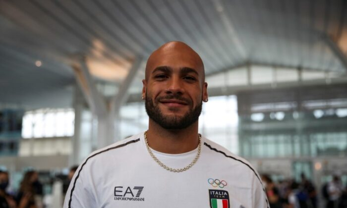 Italy's 100 metres Olympic champion Lamont Marcell Jacobs poses for a picture as he returns home to Rome at Haneda Airport in Tokyo, Japan, on Aug. 9, 2021. (Yara Nardi/Reuters)