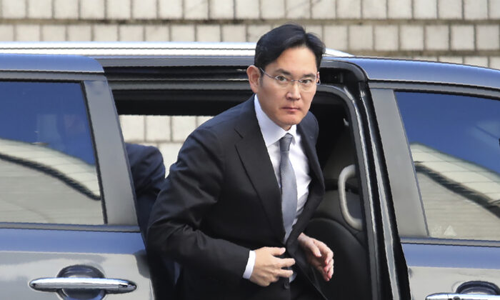 Samsung Electronics Vice Chairman Lee Jae-yong gets out of a car at the Seoul High Court in Seoul, South Korea, on Nov. 22, 2019. (Ahn Young-joon/AP Photo)