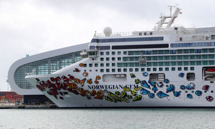 Norwegian Cruise Line's Norwegian Gem sits at the Port of Miami, awaiting a hoped-for return to service on April 8, 2021. (Susan Stocker/Sun Sentinel/TNS)