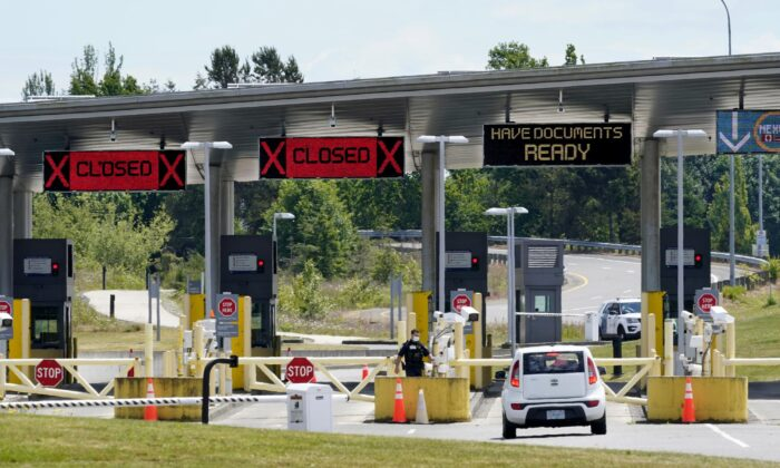 A car approaches one of the few lanes open at the Peace Arch border crossing into the United States in Blaine, Wash., on June 8, 2021. (Elaine Thompson/AP Photo)