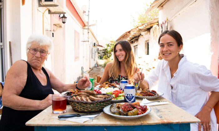 (From L to R) Yiayia Anastasia, Anastasia Miari, and Iska Lupton sit down to a home-cooked Yiayia meal in Corfu, Greece. (Ella Louise Sullivan)