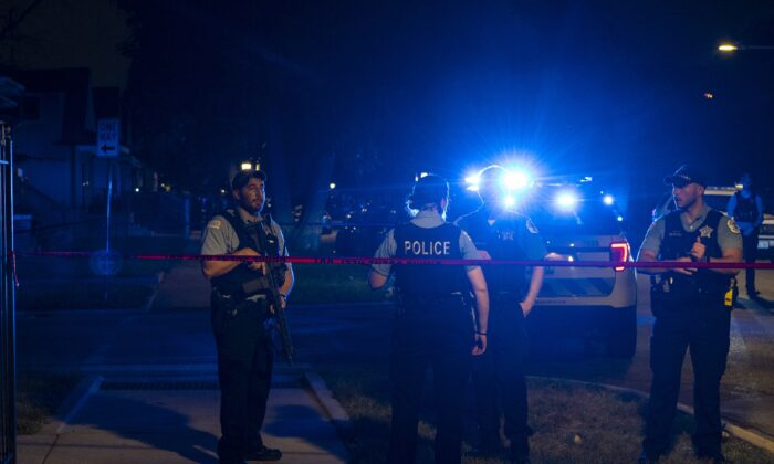 Chicago police work the scene where two police officers where shot during a traffic stop in the 6300 block of South Bell in the West Englewood neighborhood on Aug. 7, 2021. (Tyler LaRiviere/Chicago Sun-Times via AP)