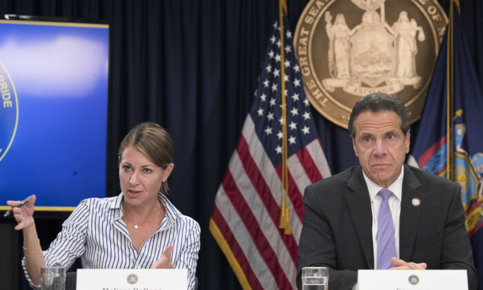 Secretary to the Governor Melissa DeRosa answers questions with Gov. Andrew Cuomo during a news conference in New York on Sept. 14, 2018. (Mary Altaffer/AP Photo)