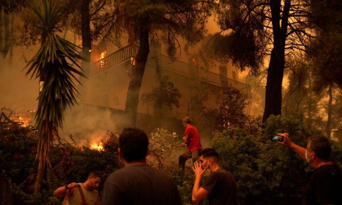 Flames burn a house at Pefki village on Evia island, about 118 miles north of Athens, Greece, on Aug. 8, 2021. (Petros Karadjias/AP Photo)