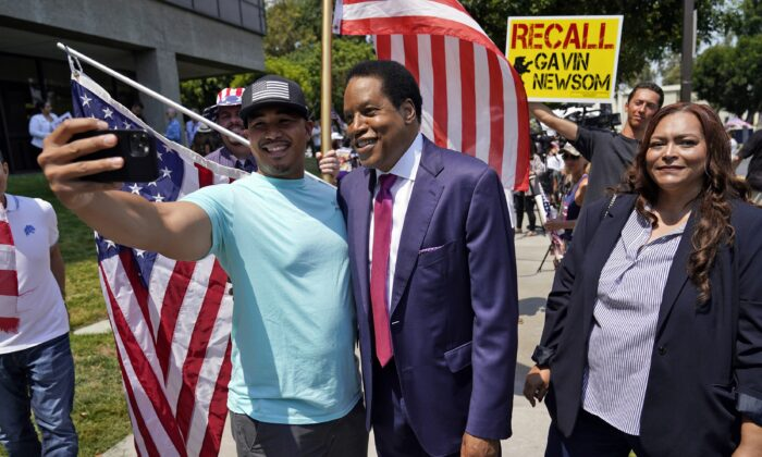 California gubernatorial candidate Larry Elder, center, poses for selfies with supporters during a campaign stop in Norwalk, Calif., on July 13, 2021. (Marcio Jose Sanchez/AP Photo)