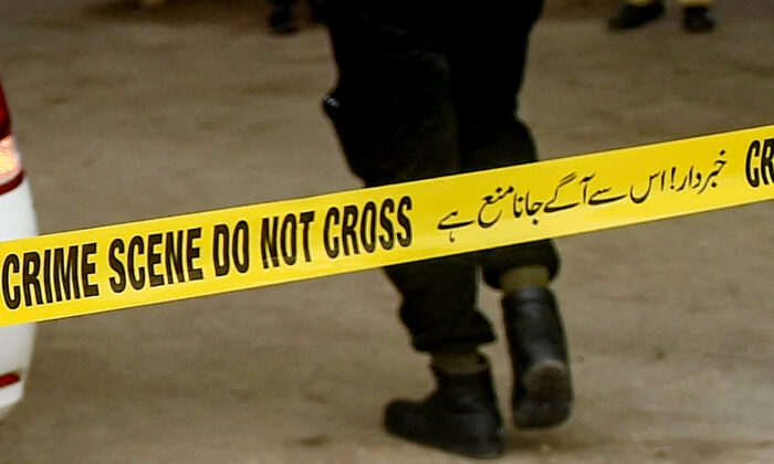 A police tape in Pakistan, in a file photo. (Rizwan Tabassum/AFP via Getty Images)