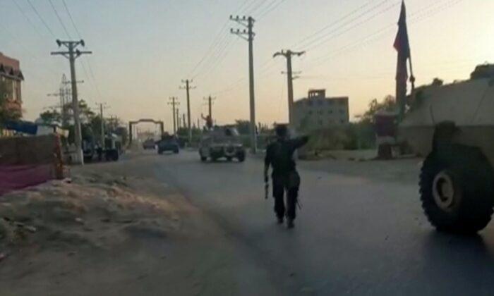 Tanks arrive at battlefield, in Kunduz, Afghanistan, on July 7, 2021. (Reuters TV via Reuters)