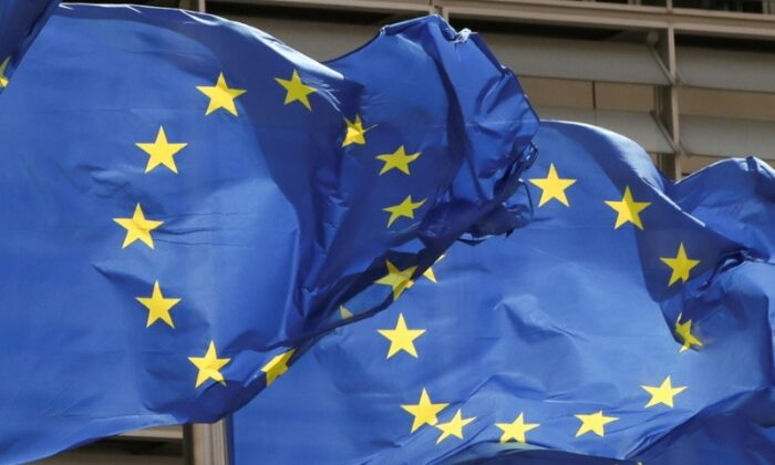 European Union flags flutter outside the EU Commission headquarters in Brussels on May 5, 2021. (Yves Herman/Reuters)