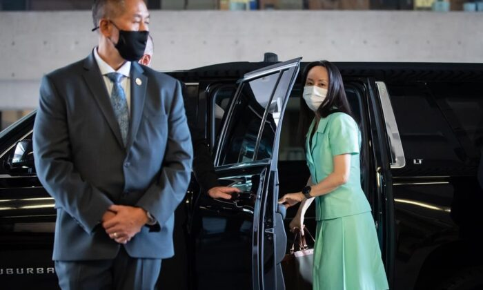Meng Wanzhou, chief financial officer of Huawei, arrives at B.C. Supreme Court to attend her extradition hearing, in Vancouver, on August 9, 2021. (The Canadian Press/Darryl Dyck)