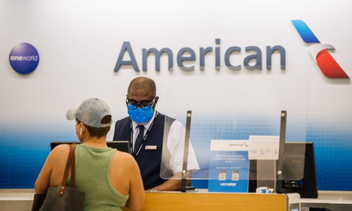 A customer is helped at an American Airlines check-in counter at the George Bush Intercontinental Airport in Houston, Texas, on Aug. 5, 2021. (Brandon Bell/Getty Images)
