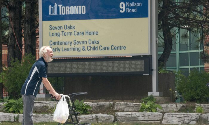 A resident takes a walk outside the Seven Oaks Long-Term Care Home in Toronto on June 25, 2020. (The Canadian Press/Frank Gunn)