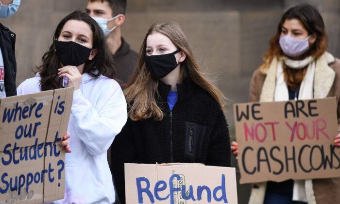 Edinburgh University students protest against the false promise of 'hybrid learning' to new and returning students in Edinburgh, Scotland, on Oct. 24, 2020. (Jeff J Mitchell/Getty Images)