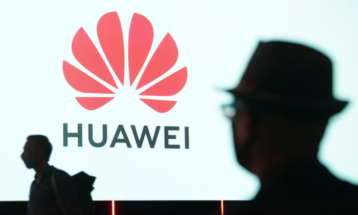 People arrive to attend the Huawei keynote address at a trade fair opening day in Berlin, Germany, on Sept. 3, 2020. (Sean Gallup/Getty Images)