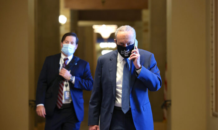 Senate Majority Leader Chuck Schumer (D-N.Y.) speaks on the phone as he walks back to his office in the U.S. Capitol building on Aug. 5, 2021. (Anna Moneymaker/Getty Images)