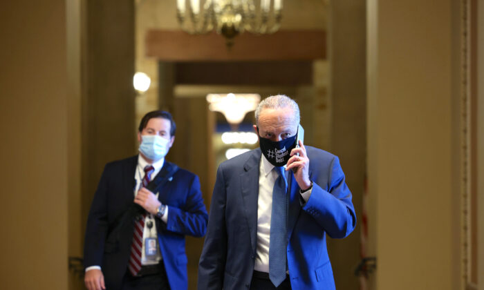 Senate Majority Leader Chuck Schumer (D-NY) speaks on the phone as he walks back to his office in the U.S. Capitol building on Aug. 5, 2021. (Anna Moneymaker/Getty Images)