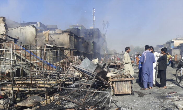 Afghans inspect damaged shops after fighting between Taliban and Afghan security forces in Kunduz city, northern Afghanistan, on Aug. 8, 2021. (Abdullah Sahil/AP Photo)