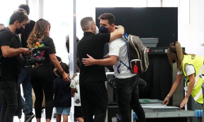 Lionel Messi is seen with his wife Antonela and their children before flying to Paris at Josep Tarradellas Barcelona-El Prat Airport, in Barcelona, Spain, on Aug. 10, 2021. (Albert Gea/Reuters)