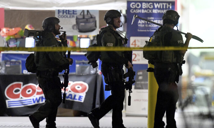Heavily armed police officers leave the Costco store following a fatal shooting of Kenneth French by an off-duty Los Angeles Police Officer Salvador Sanchez at Corona, Calif., on June 14, 2019. (Will Lester/The Orange County Register/SCNG via AP)
