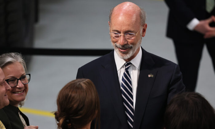 Pennsylvania Gov. Tom Wolf greets people as he awaits a speech from U.S. President Joe Biden at Mack Truck Lehigh Valley Operations in Macungie, Pennsylvania, on July 28, 2021. (Michael M. Santiago/Getty Images)