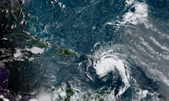 A tropical storm east of Puerto Rico in the Caribbean, at 7:50 a.m. ET, on Aug. 10, 2021. (NOAA/NESDIS/STAR GOES via AP)