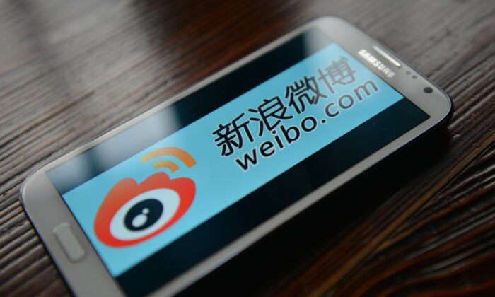 The logo of Chinese microblogging platform Weibo on a smartphone in the Chinese financial city of Shanghai, on March 19, 2014. (Peter Parks/AFP via Getty Images)