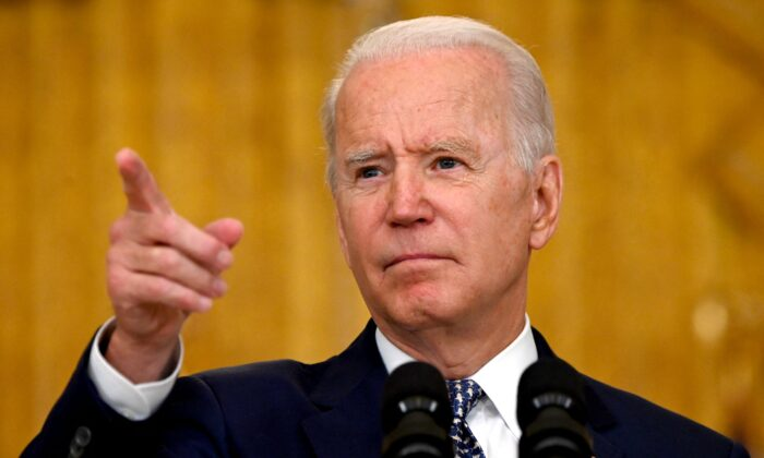 President Joe Biden takes a question during a press conference in Washington on Aug. 10, 2021. (Jim Watson/AFP via Getty Images)
