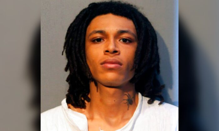 Eric Morgan, one of two brothers who have been charged in a weekend shooting during a traffic stop that left one Chicago police officer dead and another seriously wounded, in an undated booking photo. (Chicago Police Department via AP)