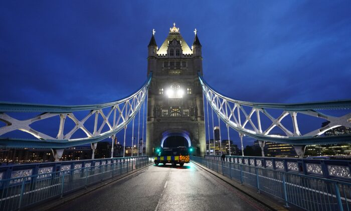 Tower Bridge in central London, which has been left open due to a technical fault, causing traffic problems, in London, on Aug. 9, 2021. (Ian West/PA)