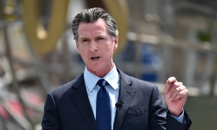 California Gov. Gavin Newsom attends press conference for the official reopening of the state of California at Universal Studios Hollywood in Universal City, Calif., on June 15, 2021. (Alberto E. Rodriguez/Getty Images)