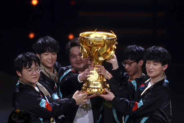 TS players celebrate with the trophy after winning the Tencent's 5v5 mobile game 2020 Glory of Kings World Cup Finals at Beijing Cadillac Center in Beijing on Aug. 16, 2020. (Lintao Zhang/Getty Images)