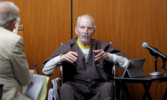 New York real estate scion Robert Durst, 78, answers questions from defense attorney Dick DeGuerin (L) while testifying in his murder trial at the Inglewood Courthouse in Inglewood, Calif., on Aug. 9, 2021. (Gary Coronado/Pool/Los Angeles Times via AP)