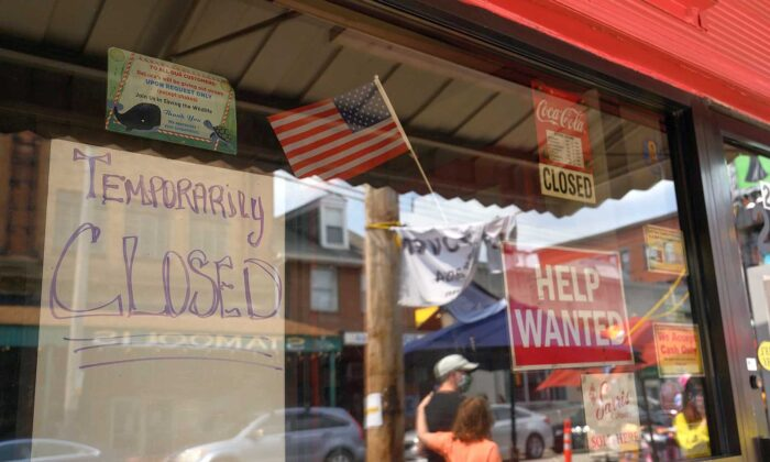 """Signs blaring """"Help Wanted"""" and """"Temporarily Closed"""" have appeared all over the Strip District. (Justin Merriman)"""