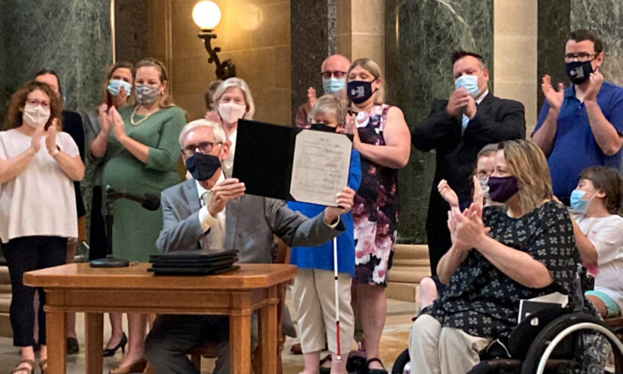 Wisconsin Gov. Tony Evers vetoes Republican bills during a news conference in the Capitol rotunda in Madison, Wis., on Aug. 10, 2021. (Scott Bauer/AP Photo)