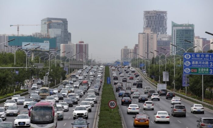Cars drive on the road during the morning rush hour in Beijing, China, on July 2, 2019. (Jason Lee/Reuters)