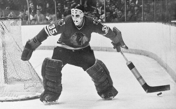 Chicago Blackhawks goalie Tony Esposito moves behind the net