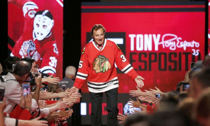 Chicago Blackhawks great Tony Esposito is introduced to the fans during the Blackhawks' convention in Chicago on July 15, 2016. (AP Photo/Charles Rex Arbogast, File)