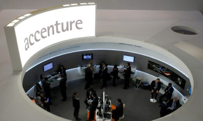 Visitors look at devices at Accenture stand at the Mobile World Congress in Barcelona,  Spain, on Feb. 26, 2013. (Albert Gea/Reuters)