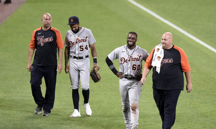 Derek Hill #54 and Akil Baddoo #60 of the Detroit Tigers come out of the game after colliding with each other in the eighth inning against the Baltimore Orioles at Oriole Park at Camden Yards in Baltimore, Md., on Aug. 10, 2021. (Greg Fiume/Getty Images)