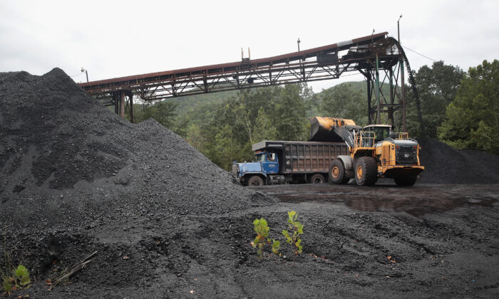 A truck is loaded with coal at a mine near Cumberland, Ky., on Aug. 26, 2019. Eastern Kentucky, once littered with coal mines, is seeing that lifeblood rapidly slip away. (Scott Olson/Getty Images)