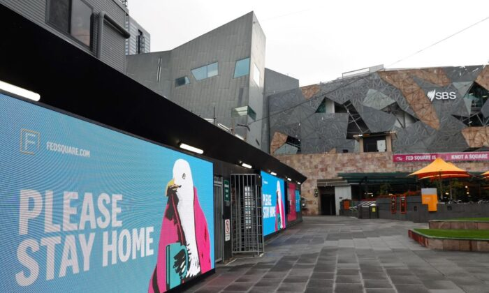 Signage for people to stay home is seen at Federation Square in downtown Melbourne, Australia, on August 6, 2021, (Con Chronis/AFP via Getty Images)
