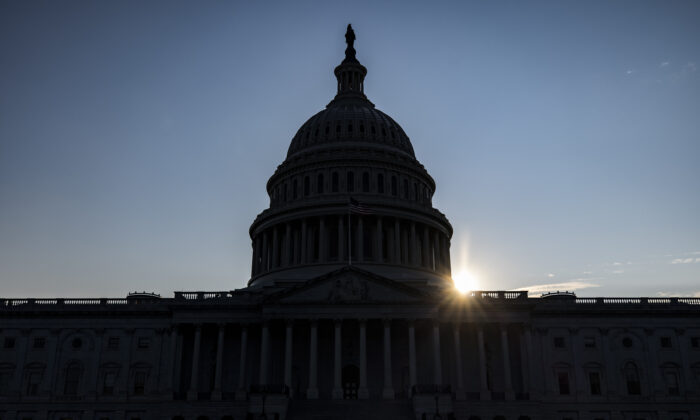 The sun begins to set behind the U.S. Capitol Building in Washington on Aug. 8, 2021. (Samuel Corum/Getty Images)