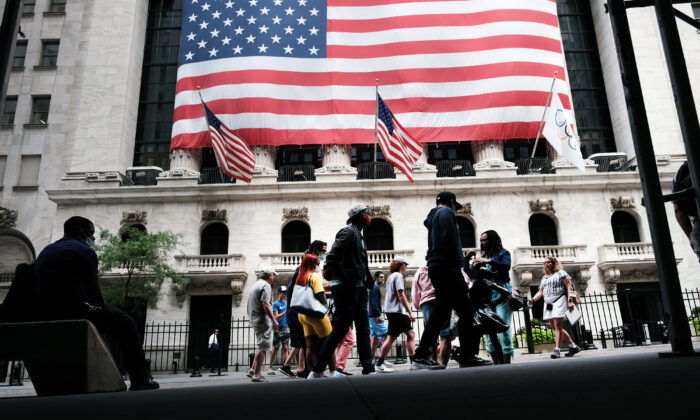 People walk by the New York Stock Exchange (NYSE) in New York City on Aug. 10, 2021. (Spencer Platt/Getty Images)