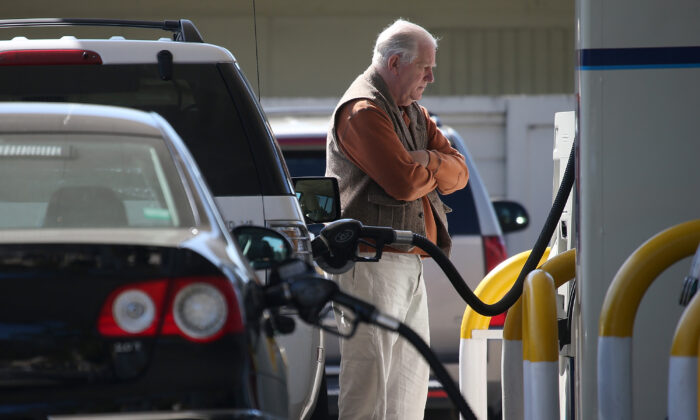 A customer pumping gasoline at an Arco gas station in Mill Valley, Calif., on March 3, 2015. (Justin Sullivan/Getty Images)