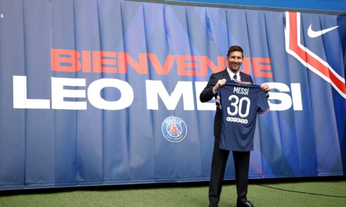 Lionel Messi Press Conference after signing for Paris St Germain. Paris St Germain's Lionel Messi poses with a shirt on the pitch after the press conference in Parc des Princes, Paris, France, on Aug. 11, 2021. (Sarah Meyssonnier/Reuters)