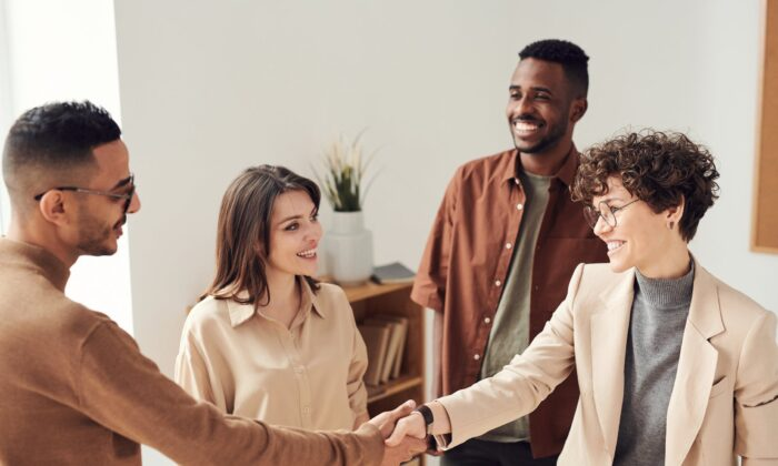 People shaking hands. (Fauxels/Pexels)