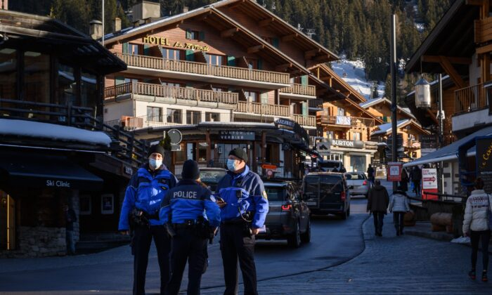 Police officers stand in the street in the Alpine resort of Verbier, Switzerland on Dec. 22, 2020. (Abrice Coffrini/AFP via Getty Images)