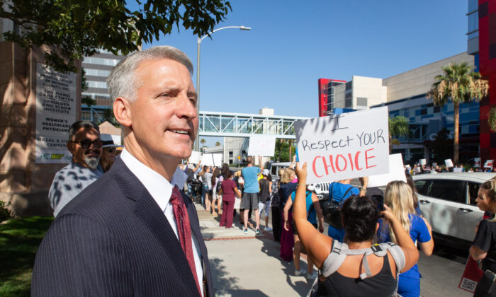 Brad W. Dacus, President of the Pacific Justice Institute, joins medical personnel to protest mandatory vaccines in Orange, Calif., on Aug. 9, 2021. (John Fredricks/The Epoch Times)