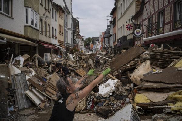 Woman throws away flood damaged rubbish